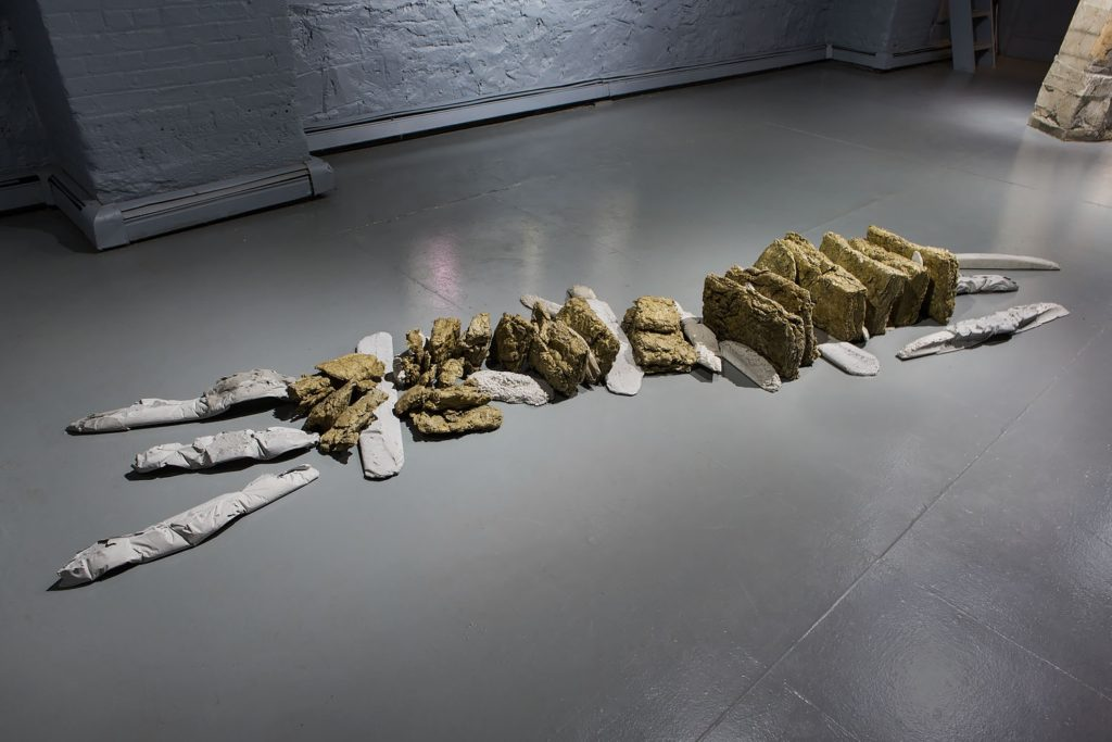 "Ruth Hardinger ""Conundrum Considerations"" 2015, concrete and stone wall, approx 12 in. high x 12 in wide x 12 ft long."