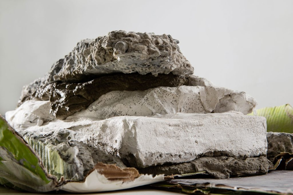 """Ruth Hardinger, detail of """"Layers Live and Rise #2"""" (2016, concrete, cardboard, graphite, plaster, marble dust, acrylic, 50"""" x 24"""" x 8"""")"""